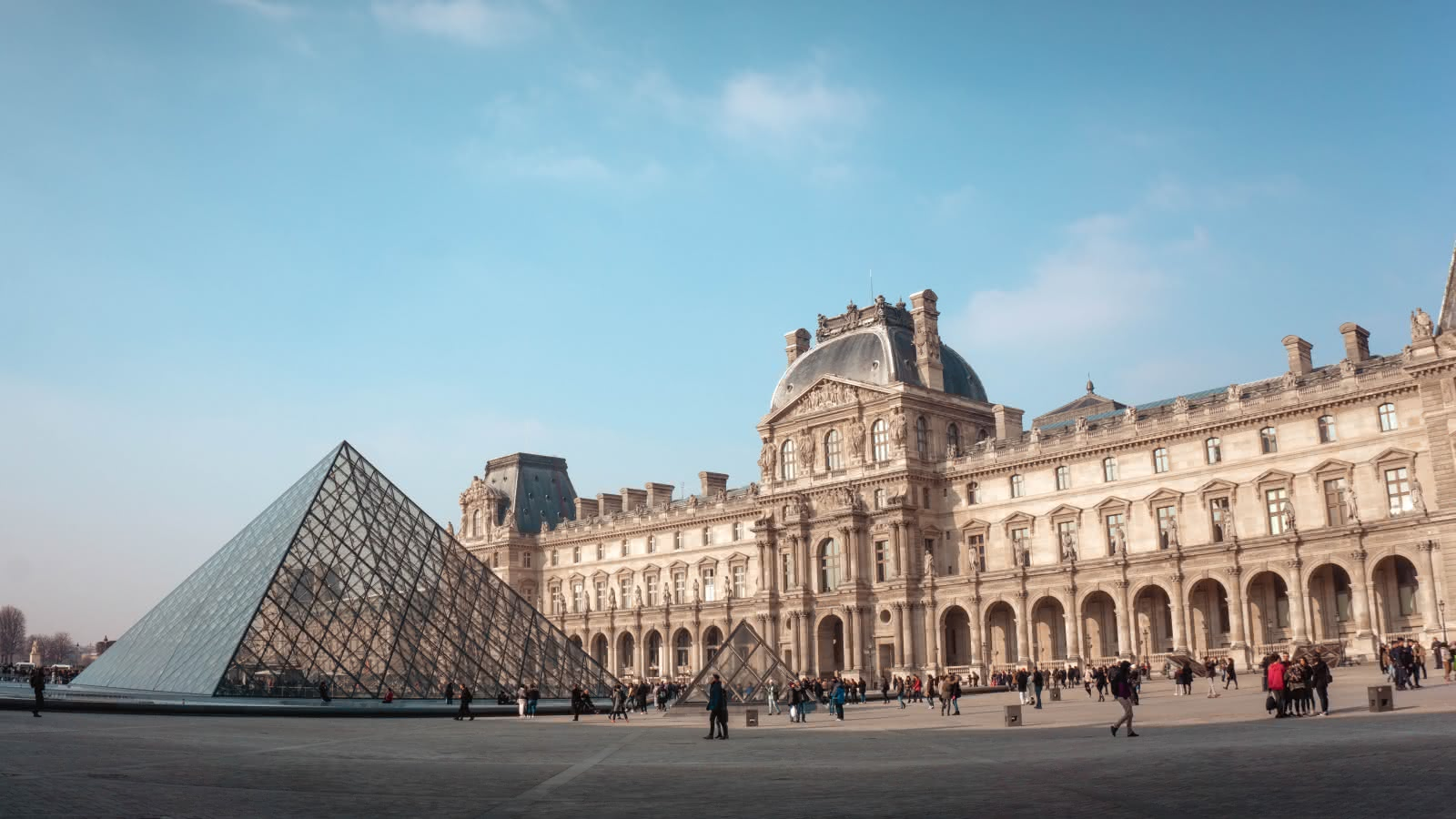 Visiting the Louvre grounds during the Paris Free Tour