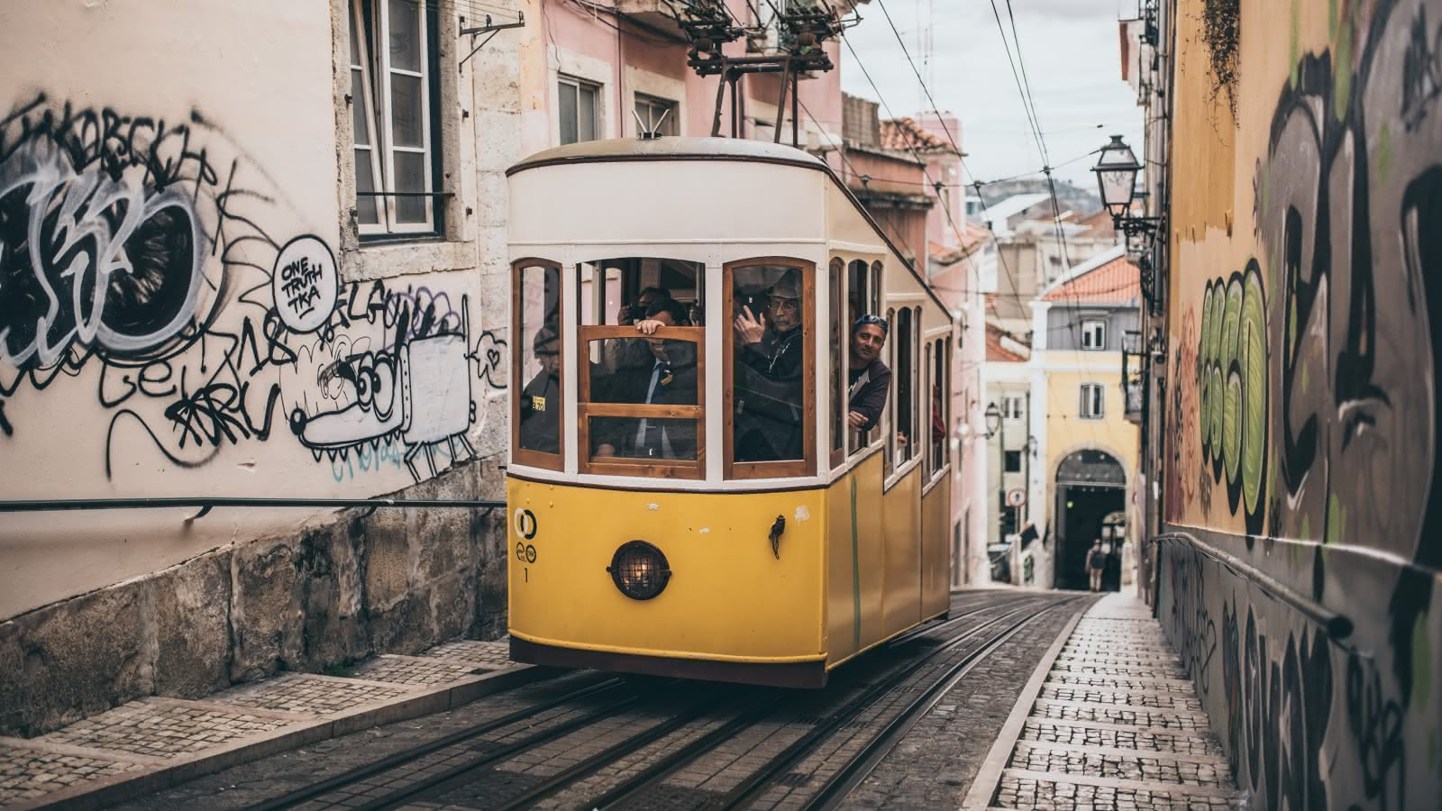 a typical lisbon tram going up the street